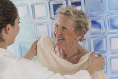 caregiver assisting senior woman for shower